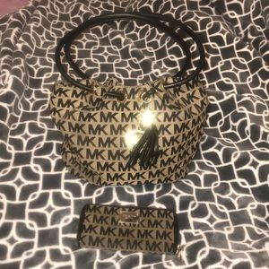 Authentic Michael Kors purse with matching wallet